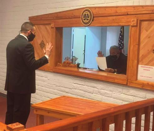 Carl Ustupski takes the Oath of Office on Feb. 17 at the Village of Milan Municipal Court. Village of Milan courtesy photo
